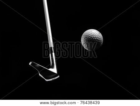 Golf Club Hitting a Golf Ball