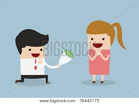 Businessman Kneeling Down Giving Flower To Woman