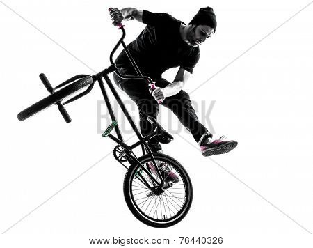 one  man exercising bmx acrobatic figure in silhouette studio isolated on white background