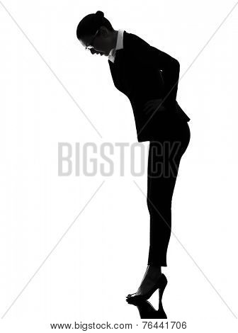 one  business woman bending looking down surprised in silhouette on white background