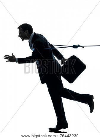 one  business man catched by lasso rope in silhouette studio isolated on white background