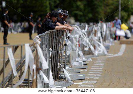 Policemen Settled Back On A Fence