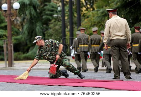 Military Cleaning A Red Carpet