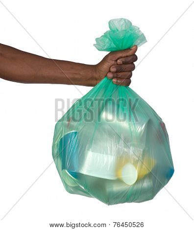 Man holding a plastic bag full of garbage, isolated on white background