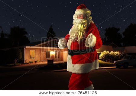 A unique and Rare Shot of Santa Claus, yes SANTA CLAUS as he walks in front of a house and gives you the Thumbs Up sign. Even Santa Claus needs exercise and walks around neighborhoods at night.