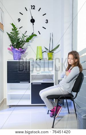 Little girl waiting at the dentist
