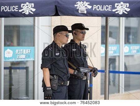 Two Chinese Police Officers On Their Post