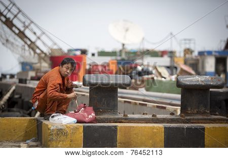 Chinese Worker Having A Lunch
