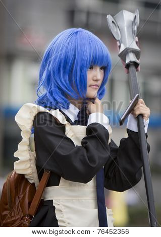 Manga Girl With A Scythe And Blue Hair