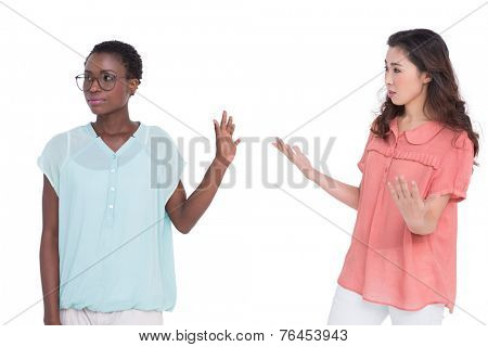 Female friends having a disagreement on white background