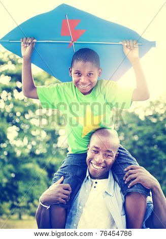 African Father and Son Piggyback Playing Concept