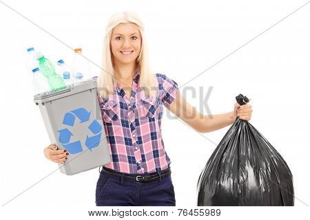 Woman holding a recycle bin and a trash bag isolated on white background