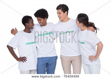 Young smiling volunteers looking at camera on white background