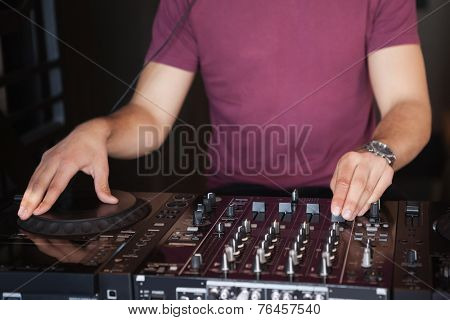 Cool dj spinning the decks at the nightclub
