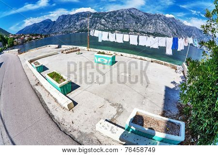 Wet clothes drying on the pier near the sea. Montenegro. Fish eye look