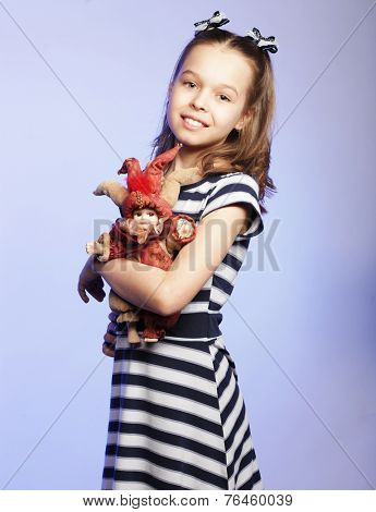 little girl holding doll