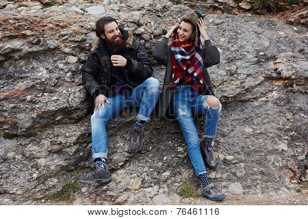 Friendly smile of two guys during adventure mountain expedition