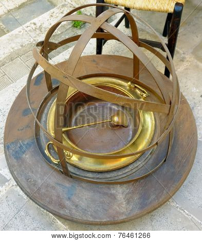 Old brass brazier with handles on wooden platform