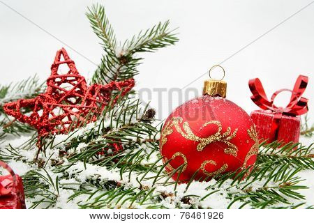Red Christmas Gifts,baubles With Red Star And Needles Fir On Sno