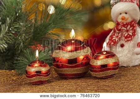 Candles With Christmas Decorations In Atmospheric Light