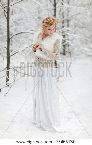 Portrait of beautiful woman in winter park