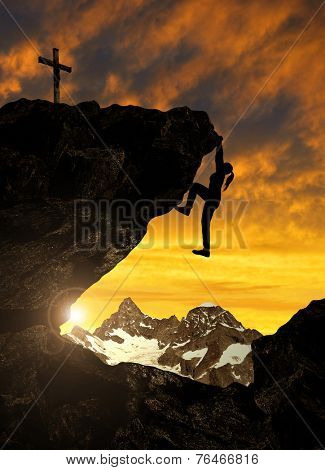 Silhoutte of girl climbing on rock at sunset. In the background Gabelhorn - Swiss