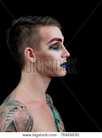 Handsome young man fashion model with make-up