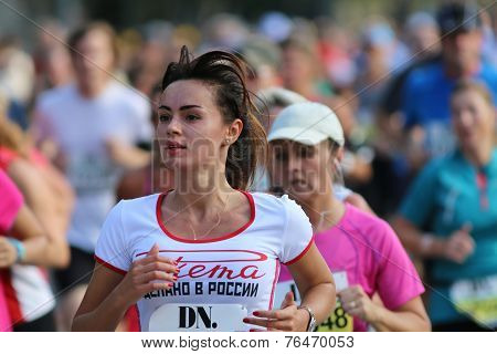 Young Beautiful Woman Running