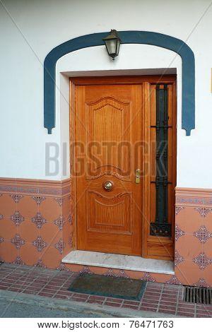 Modern door with metal grille