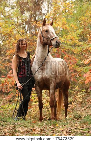 Nice Girl With Long Hair Standing Next To Amazing Horse In Autumn