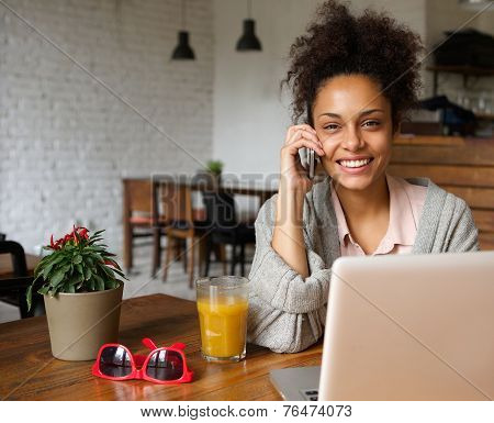 Attractive You Woman Talking On Phone At Home