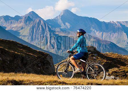Cyclist Woman In Hight Mountais