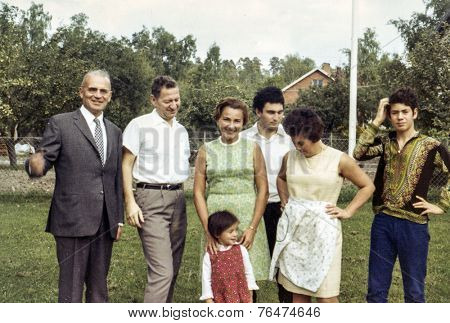 STOCKHOLM, SWEDEN, CIRCA SEPTEMBER 1969: Vintage photo of family with little girl outdoor