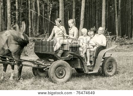 POLAND, CIRCA SIXTIES: Vintage photo of family traveling by horse-drawn carriage