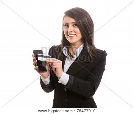 Smiling attractive elegant woman paying with smartphone