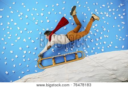 Young man on sled having fun