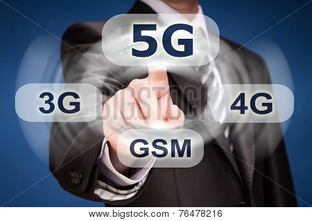 Businessman Pushing Finger On 5G Button