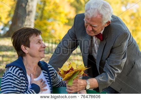 Man Giving The Buquet