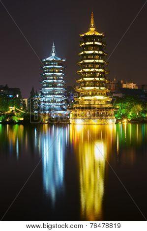 The Sun and Moon pagodas at Banyan Lake, Guilin, Guangxi, China. May, 06 2009.