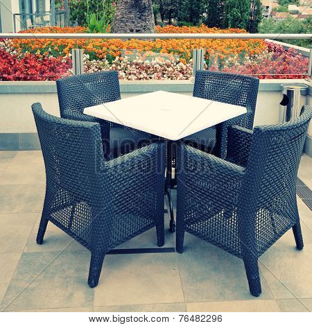 Hotel Terrace With Table And Chairs
