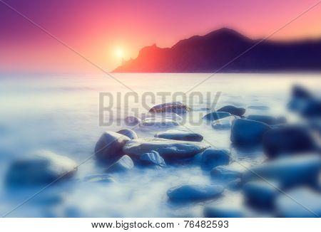 Fantastic morning blue sea glowing by sunlight. Dramatic scene. Black Sea, Crimea, Ukraine, Europe. Beauty world. Retro style filter. Instagram toning effect. Tilt Shift blur effect.