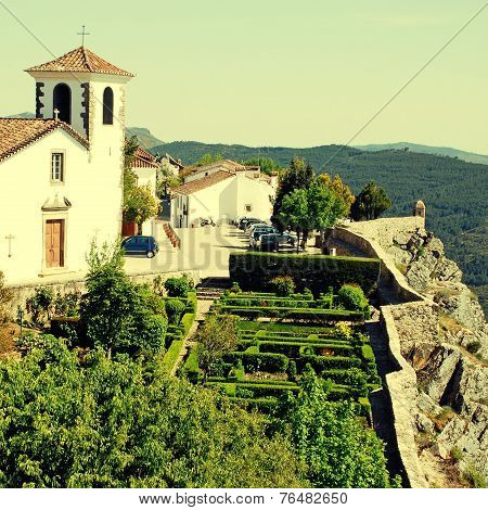 White Cathedral And Ornamental Garden In Medieval Village Marvao