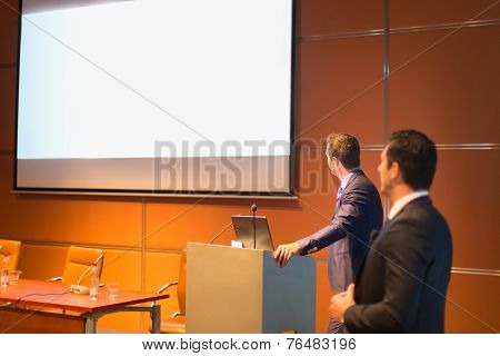 Public speaker at Business Conference.