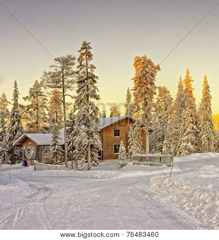 Wooden Cottage House At Winter Lapland