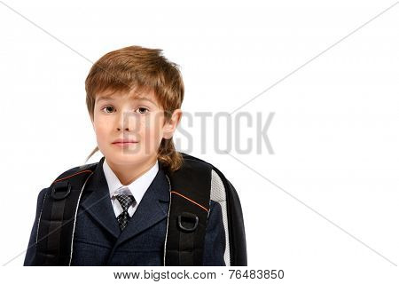 Portrait of a boy in a formal suit with schoolbag. Education. Copy space. Isolated over white.
