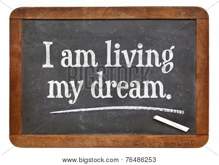 I am living my dream - positive affirmation words on a vintage slate blackboard