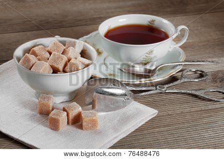 Brown lump sugar and a cup of tea