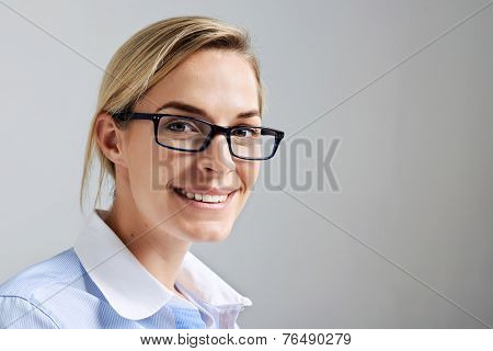 Portrait of a business intern woman with glasses smiling and happy
