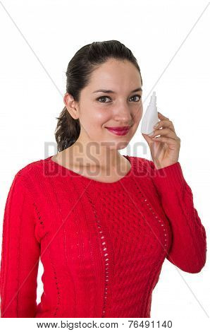 beautiful young woman holding eye drop bottle