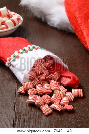 Peppermint Candy Spilling From A Christmas Stocking